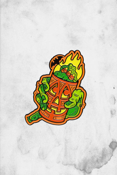 dumb junk halloween tiki themed enamel pin