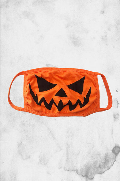 halloween themed pumpkin face mask covering COVID-19