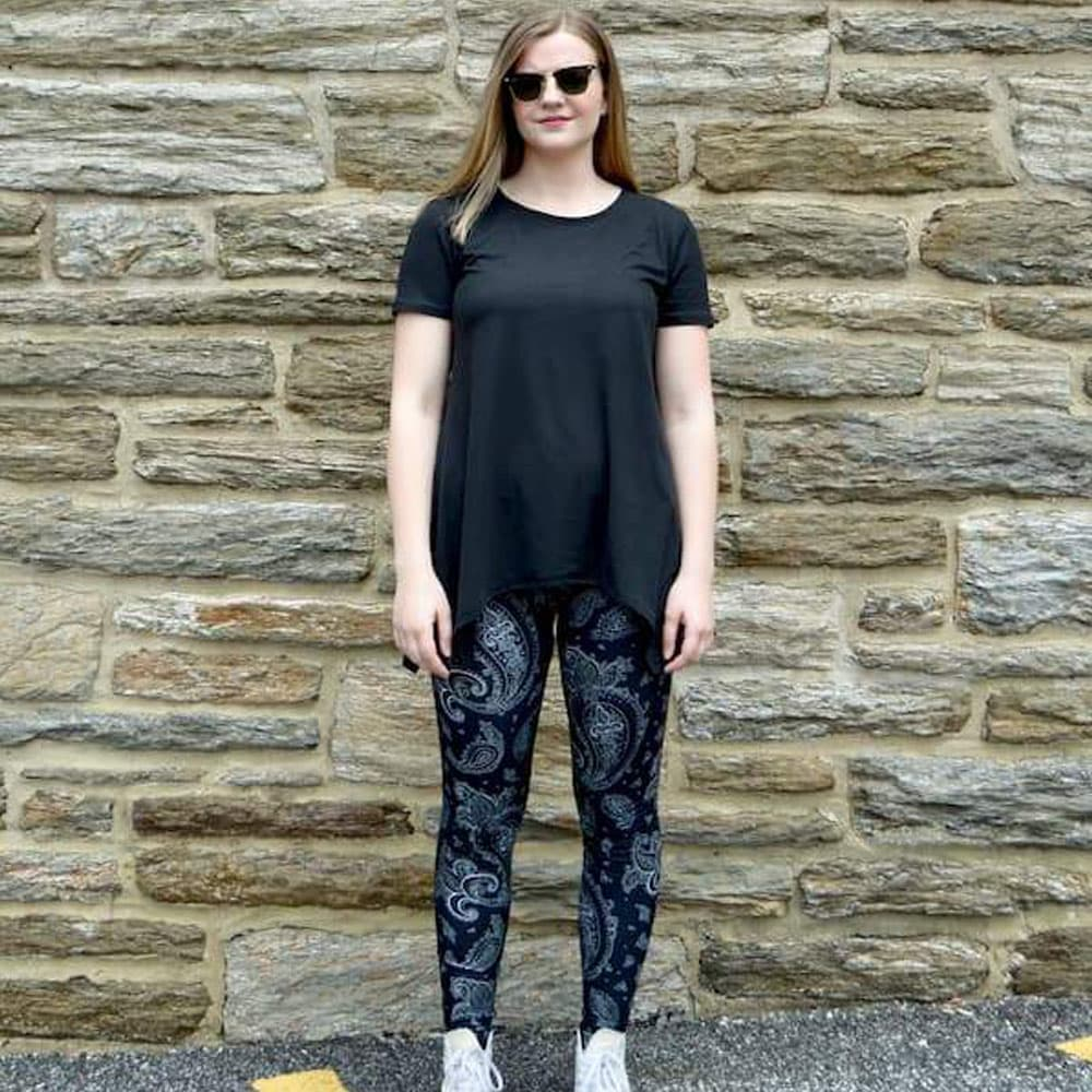 Model showing front view of black paisley pattern leggings sold by Jolina Boutique