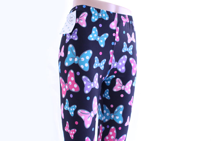 Who doesn't love Minnie!? Tap into your inner Minnie with these animated bowtie leggings by Jo Lina Boutique