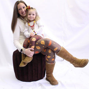 Mother and daughter wearing Autumn themed leggings by Jolina Boutique