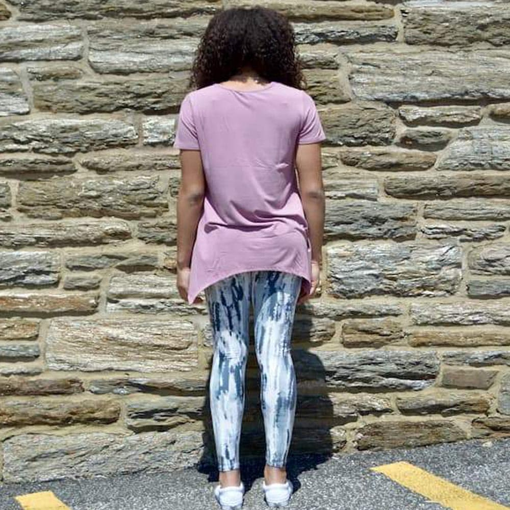Model showing the back view of her gray haze pattern leggings by Jolina Boutique