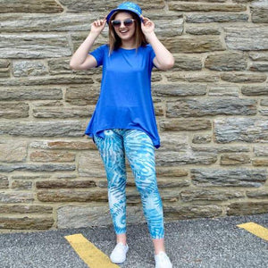 Model shown laughing and posing with laguna breeze pattern leggings sold by Jolina Boutique