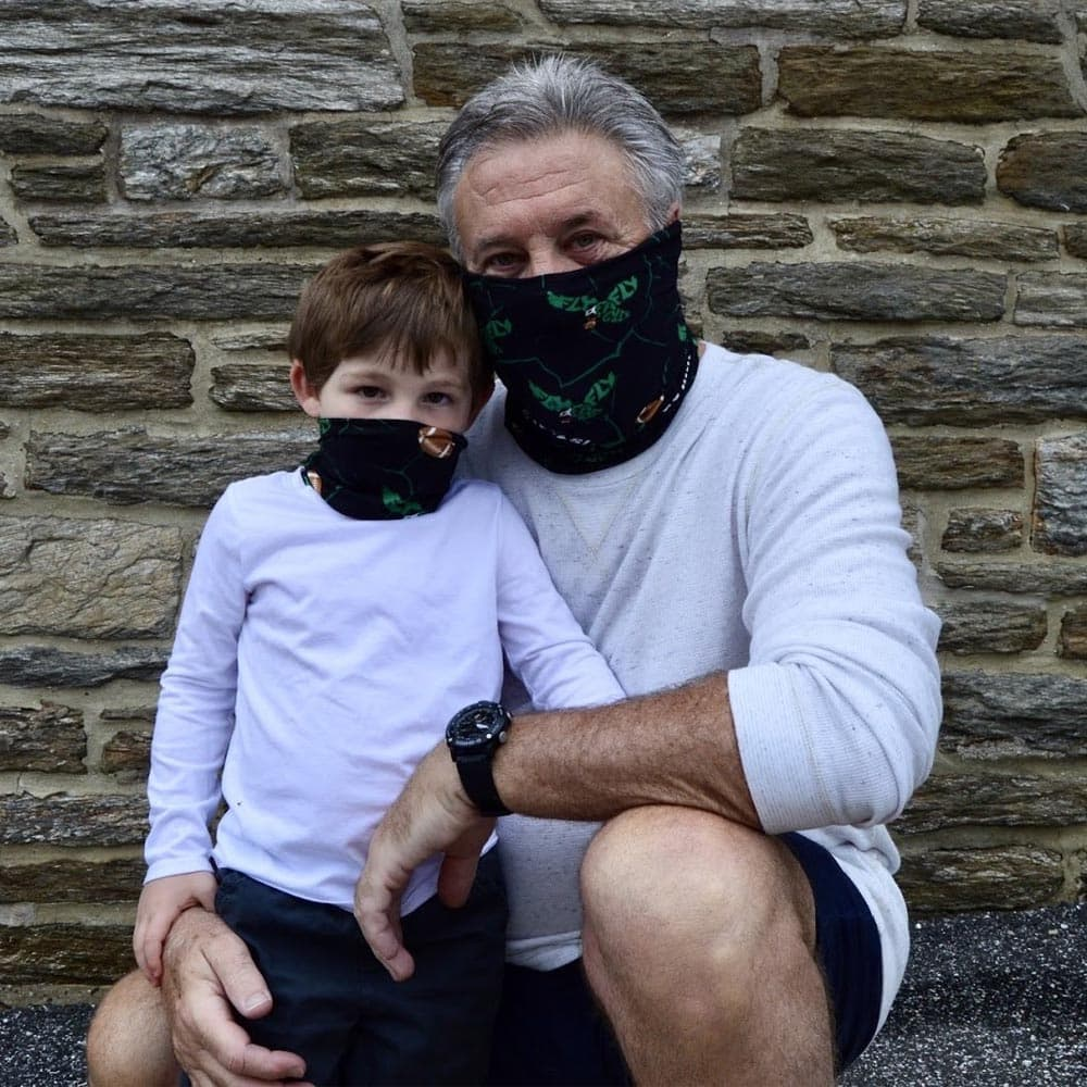 Philadelphia football bleed green face covers worn by an adult and kid