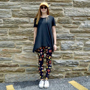 Model wearing Philly LOVE pattern leggings  by Jolina Boutique