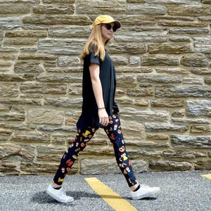 Model walking wearing Philly LOVE pattern leggings by Jolina Boutique