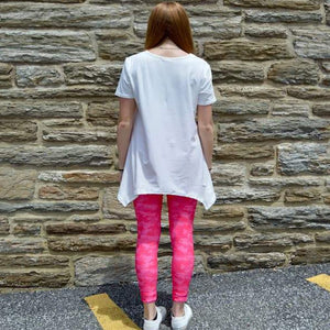 Model showing back view of pink camo leggings