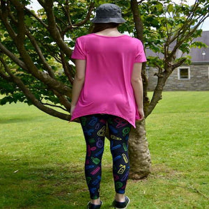 Model showing back view of sassy stylist pattern leggings by Jolina Boutique