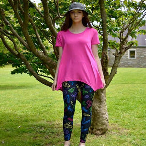 Model wearing sassy stylist pattern leggings by Jolina Boutique