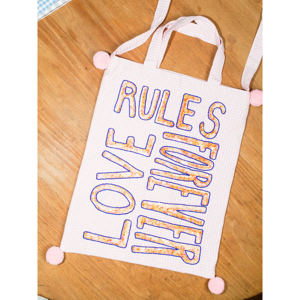 'Couture Carry All' bag love rules forever pink
