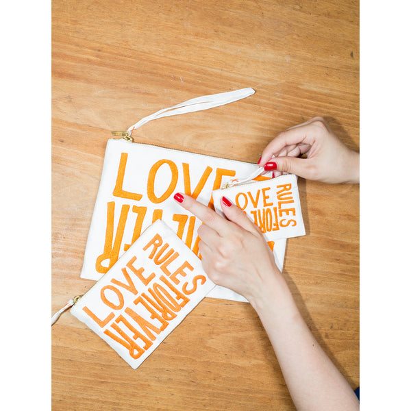 'Love Rules Forever' pouches white