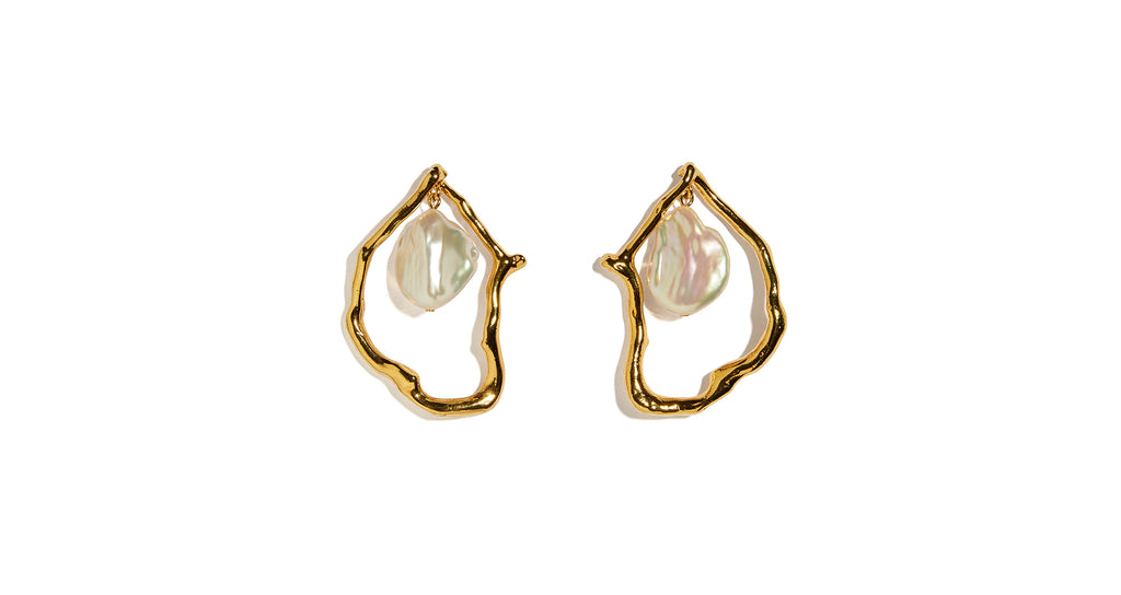 Full view of Formation Earrings In Pearl. These gold-plated abstract statement earrings are artistic, earthy and elegant-- talk about a fantastic union! With hanging freshwater pearl drops for a luminous look.