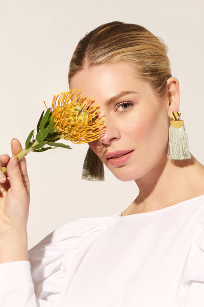 Thumbnail of model wearing the Crater Earrings In Sage. Our beloved Crater Earrings are the ...