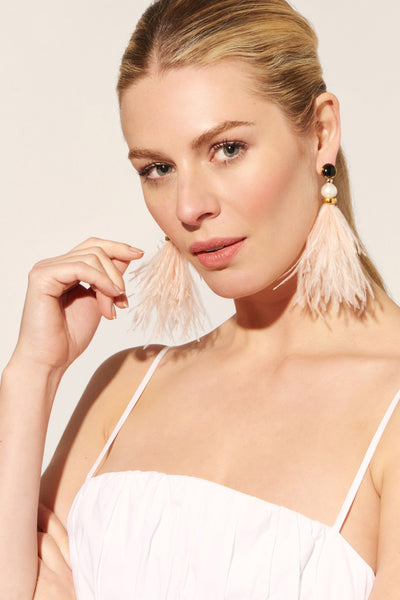 Thumbnail of model wearing the Parker Earrings In Blush. Are you blushing? Bring a majorly p...