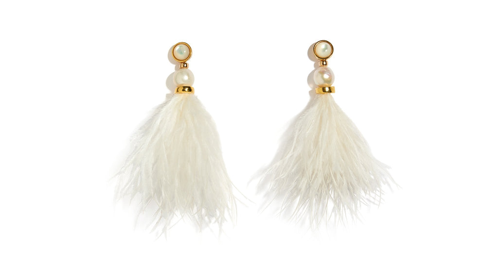 Full view of Parker Earrings In Ivory. There's no other way to say it-- these frothy ivory feather earrings are outfit game-changers and all-out statement-makers. A bouquet of ostrich feathers are capped with gold-plated beads, baroque pearls and mother-of-pearl tops.
