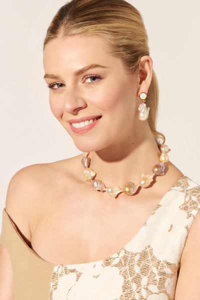 Thumbnail of model wearing the Tuxedo Baroque Pearl Earrings. When in doubt, dress up! We love an all-out black-tie affair, and you'll look nothing short of radiant in our gold-plated earrings with mother-of pearl-tops and hanging baroque pearls.