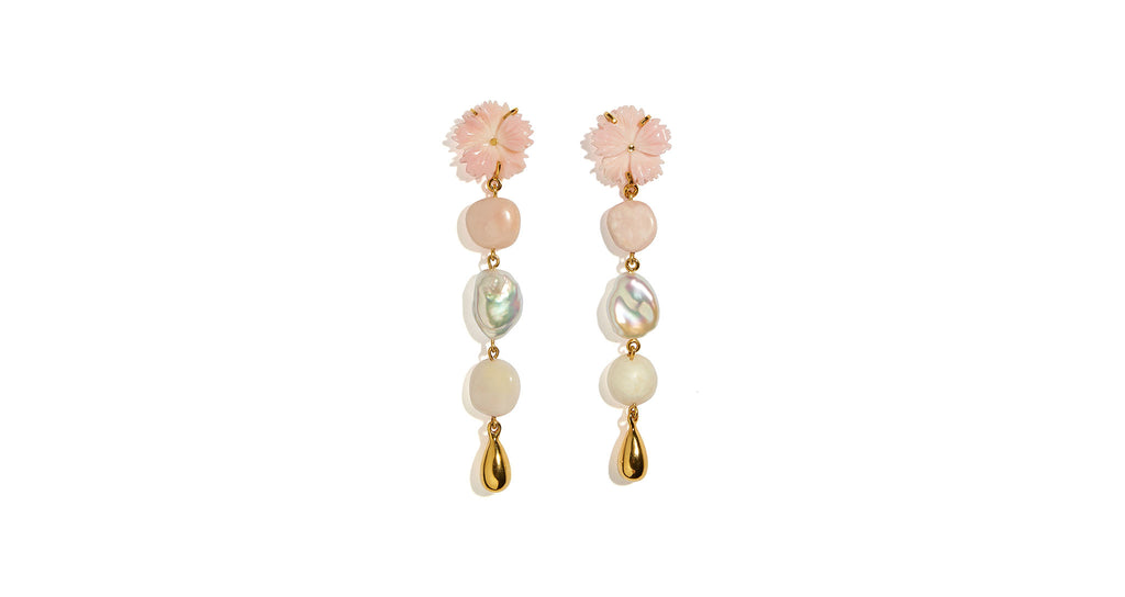 Full view of Daisy Chain Pearl Earrings. Whether you're walking down the aisle or just strolling through your neighbourhood, these mixed-media charmers have got you covered. The linked column earrings feature pink conch flower tops, pink opal and morganite beads, freshwater pearls and gold-plated brass drops.
