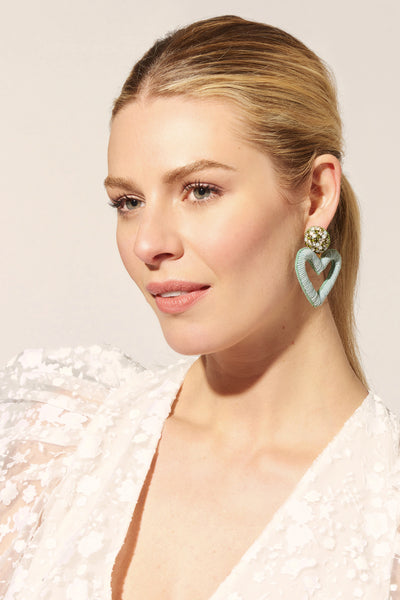 Thumbnail of model wearing the Embellished Heart Earrings In Sage. Keep your creative style ...