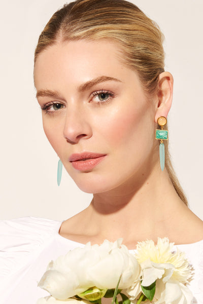 Thumbnail of model wearing Something Blue Earrings. Look sharp and bring a pop of color to t...