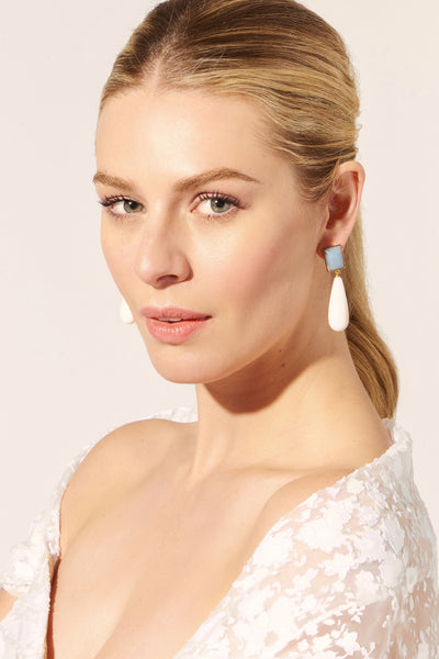 Thumbnail of model wearing the Elegance Earrings. Here's to a perfectly polished pair. Celeb...