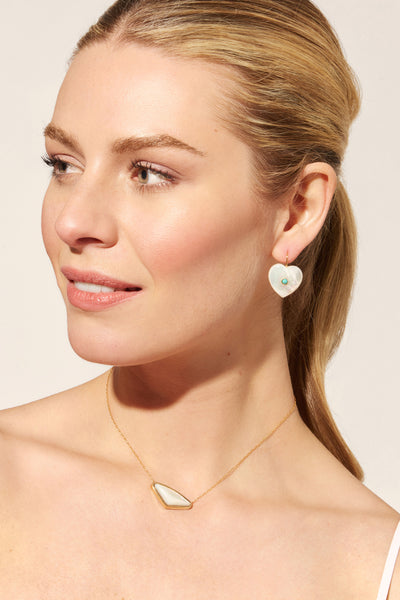 Thumbnail of model wearing the Forever Earrings In Pearl. All you need is love! Wear your he...