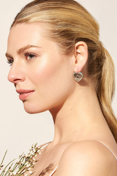 Thumbnail of model wearing the Forever Earrings In Black Pearl. You want it darker? Wear you...