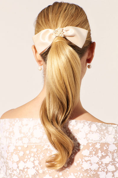 Thumbnail of model wearing the Oversized Bow Hair Comb. Lizzie designed this hair comb with ...