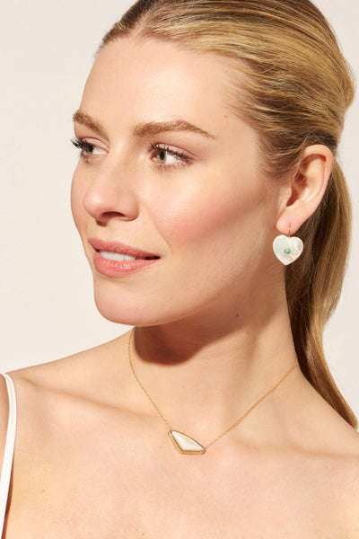 Thumbnail of model wearing the Kate Necklace In Pearl. From a white wedding to everyday wear, our gold vermeil pendant necklace with pearl triangle is a true accessory essential. This piece makes a stellar gift for your best friend or bridesmaids!