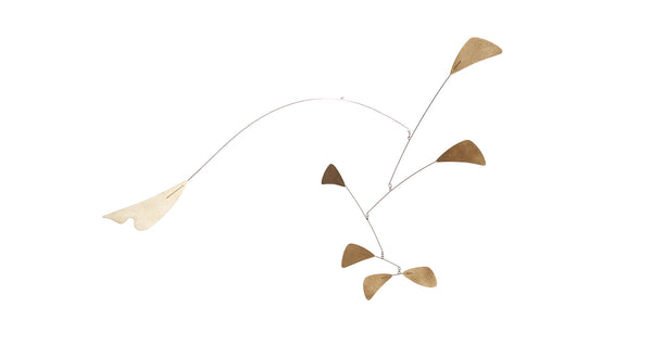 Full view of Abstract Brass Mobile. Based on the abstract mobiles of the mid-century era, the elements are cut as stylized leaves with an elegant brass and black color scheme. Makes a playful yet graceful statement.