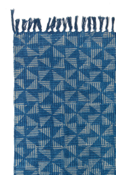 Close-up thumbnail of Batik Indigo Dhurrie Rug. East meets west in this one-of-a-kind handwoven block-printed rug; the pinwheel pattern reminds us of heritage Americana while the meticulous craftsmanship is pure India.