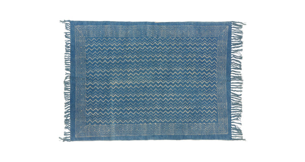 Full view of Batik Indigo Dhurrie Rug. Lizzie found this block-printed deep blue rug in Rajasthan, India and fell in love with its graphic zig-zag stripes. This durable rug is perfect for kitchens and entryways.