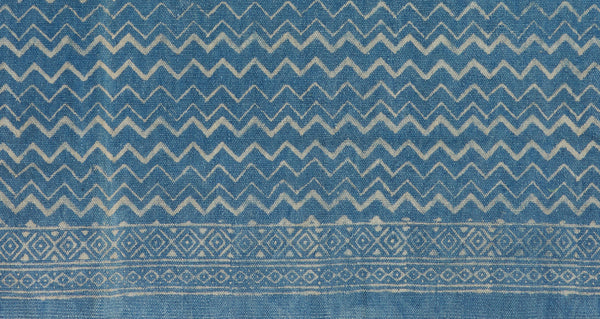 Pattern detail of Batik Indigo Dhurrie Rug. Lizzie found this block-printed deep blue rug in Rajasthan, India and fell in love with its graphic zig-zag stripes. This durable rug is perfect for kitchens and entryways.