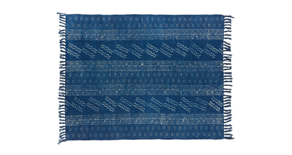 Full view of Batik Indigo Dhurrie Rug. Lizzie found this hand-woven deep blue rug in India and fell in love with its playful block-printed patterns. This durable rug is perfect for kitchens and entryways.