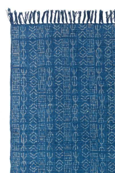 Thumbnail detail of Batik Indigo Dhurrie Rug. Lizzie found this hand-woven deep blue rug in Rajasthan, India and fell in love with its modern, muted block-printed patterns. This durable rug is perfect for kitchens and entryways.