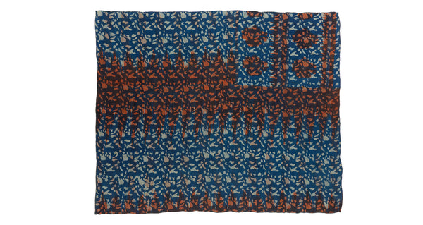 "Full view of Vintage Kantha. We love the unique indigo tone and orange overdye of this vintage kantha from Jaipur, India. Three panels of cotton (oftentimes from saris) are hand-stitched together with fine ""kantha"" stitches."