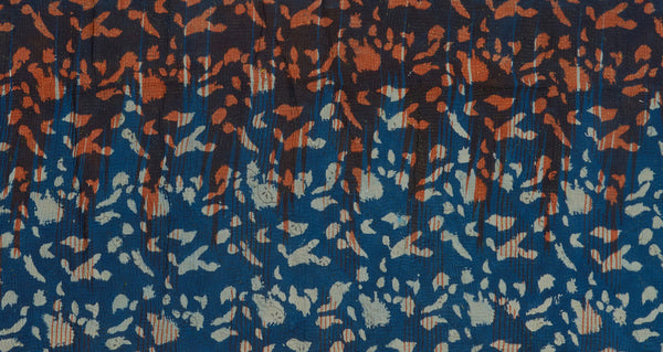 "Pattern detail of Vintage Kantha. We love the unique indigo tone and orange overdye of this vintage kantha from Jaipur, India. Three panels of cotton (oftentimes from saris) are hand-stitched together with fine ""kantha"" stitches."
