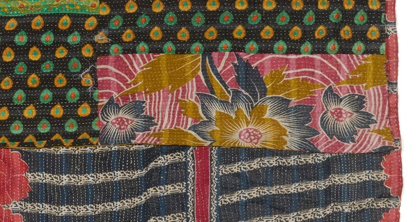 "Pattern and patch details on Vintage Kantha. This one-of-a-kind vintage kantha quilt from Jaipur, India is simply stunning with its mix of stripes, florals, and abstract patterns. Three panels of cotton (oftentimes from saris) are hand-stitched together with fine ""kantha"" stitches."