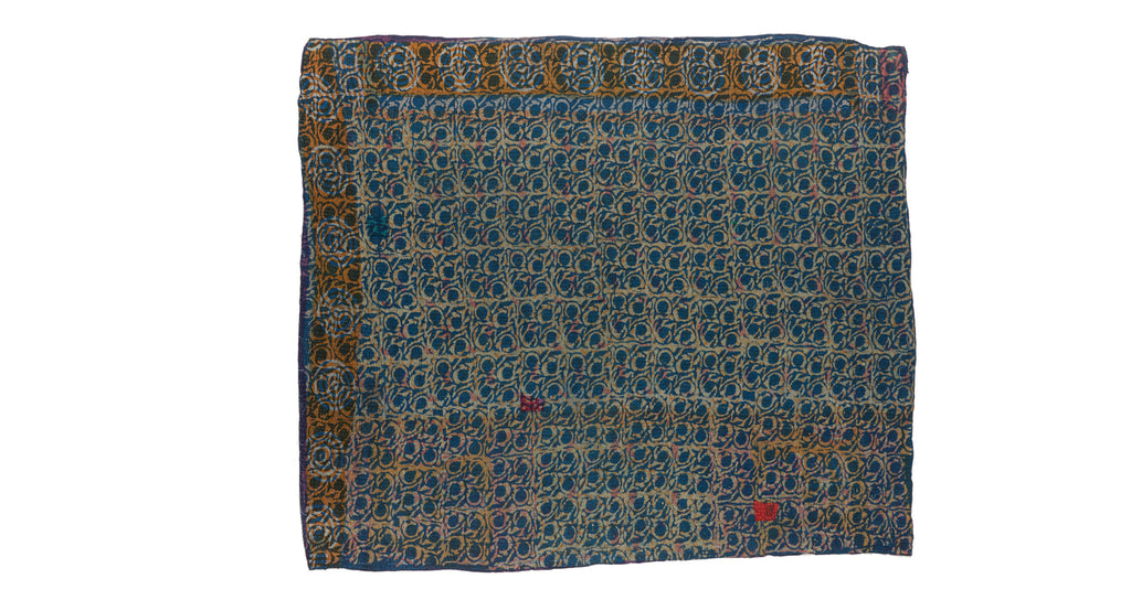 "Full view of Vintage Kantha. Three panels of cotton (oftentimes from saris) are hand-stitched together with fine ""kantha"" stitches to create this one-of-a-kind find. The small red patch could be considered an imperfection but we think it adds to the unique beauty of this hand-crafted quilt."