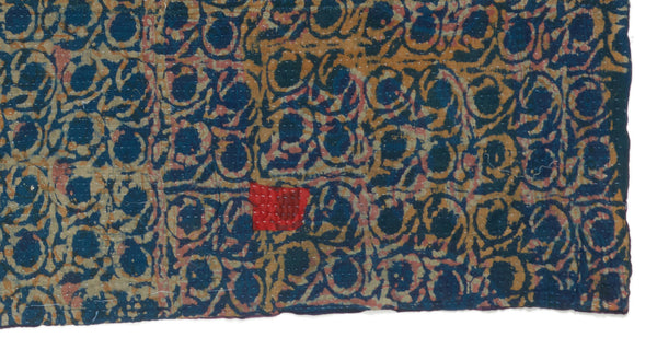 "Patter and patch detail of Vintage Kantha. Three panels of cotton (oftentimes from saris) are hand-stitched together with fine ""kantha"" stitches to create this one-of-a-kind find. The small red patch could be considered an imperfection but we think it adds to the unique beauty of this hand-crafted quilt."