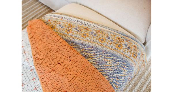 "Pattern close-up of Vintage Kantha. We love the artful mix of patterns on this unique quilt. Three panels of cotton (oftentimes from saris) are hand-stitched together with fine ""kantha"" stitches to create this one-of-a-kind find."