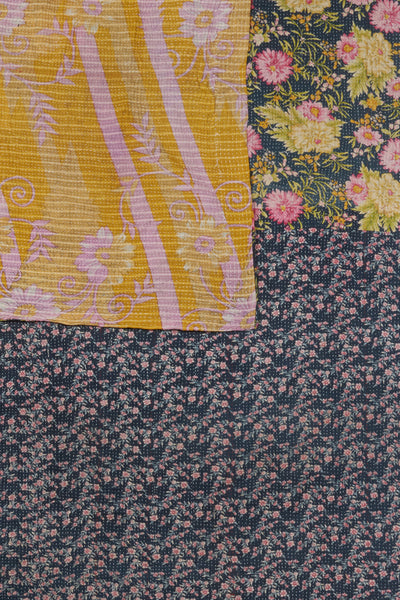 "Thumbnail detail of Vintage Kantha. Three panels of cotton (oftentimes from saris) are hand-stitched together with fine ""kantha"" stitches to create this one-of-a-kind find. Made in Jaipur, India, we love the play on scale and pretty floral patterns on this quilt."