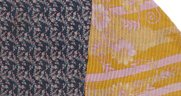 "Dual pattern close-up of Vintage Kantha. Three panels of cotton (oftentimes from saris) are hand-stitched together with fine ""kantha"" stitches to create this one-of-a-kind find. Made in Jaipur, India, we love the play on scale and pretty floral patterns on this quilt."