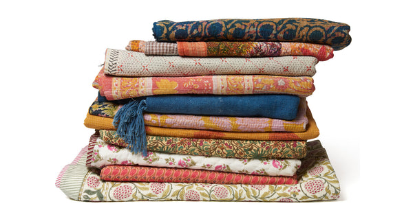 Stack of Indian textiles from Fortune Finds, including the Vintage Kantha.