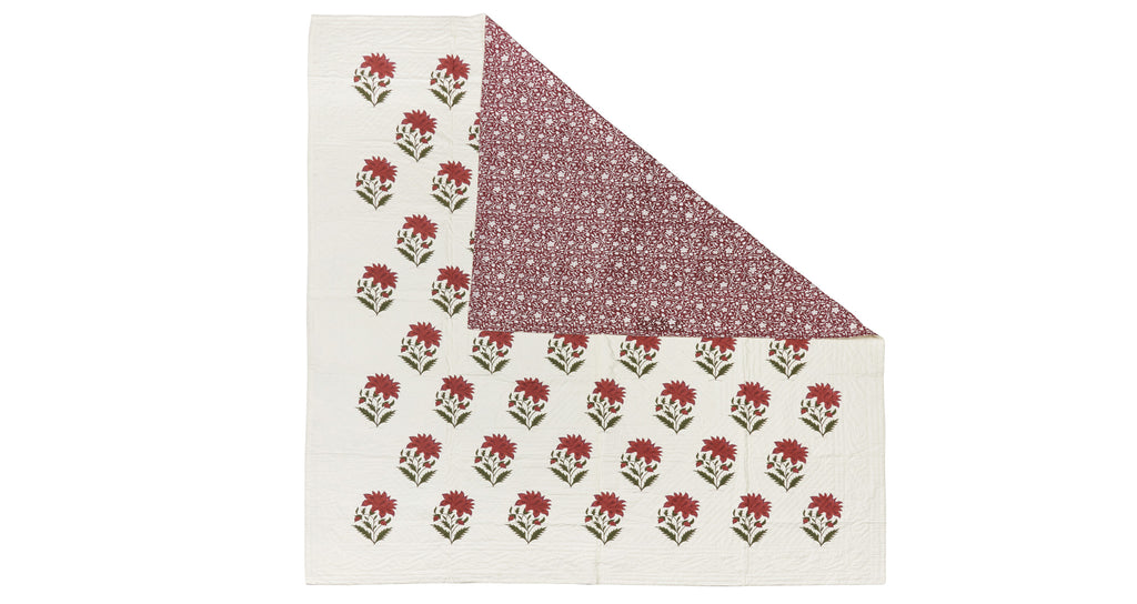 Full view of Queen Size Bedspread. This gorgeous floral pattern bed cover is made of quilted jacquard and block-printed completely by hand in Jaipur, India. And surprise! It's reversible, so you can change up the motif on your bed.