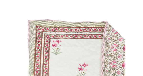 Detail view of Twin Size Bedspread. We are so in love with this sweet reversible quilt; perfect for a twin size bed or to cozy up with on the sofa. Block-printed completely by hand in Jaipur, India.