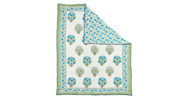 Full view of Twin Size Bedspread. We adore the blue and green color palette on this sweet reversible quilt; perfect for a twin size bed or to cozy up with on the sofa. Block-printed completely by hand in Jaipur, India.