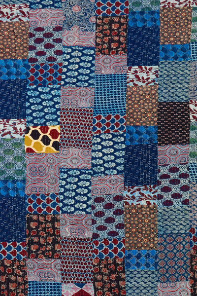 "Thumbnail detail of Kantha Quilt. It takes weeks to meticulously hand-stitch together the three panels of cotton with fine ""kantha"" stitches to make this quilt. The patchwork fabrics on this piece are particularly fun and unique! Made with care in Jaipur, India."
