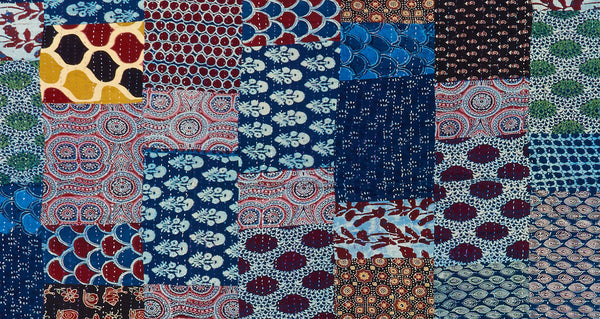 "Pattern detail of Kantha Quilt. It takes weeks to meticulously hand-stitch together the three panels of cotton with fine ""kantha"" stitches to make this quilt. The patchwork fabrics on this piece are particularly fun and unique! Made with care in Jaipur, India."