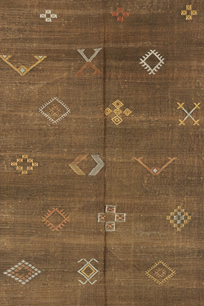 Thumbnail close-up of Large Moroccan Rug. We love this soft brown hand-woven silk rug for it...