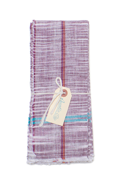 Thumbnail close-up of Cotton Napkin Set. Bring a colorful, rustic touch to your next meal with this hand-woven purple cotton napkin set with raw edges. Made with care in India.